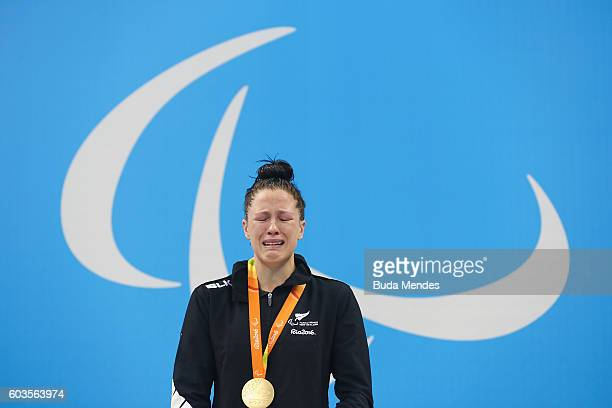 Gold medalist Sophie Pascoe of New Zealand poses on the podium at the medal ceremony for the Womens 100m Butterfly S10 Final during day 5 of the Rio...