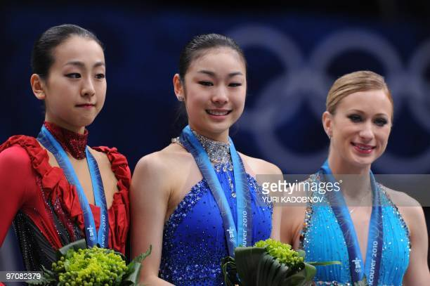 Gold medalist South Korea's YuNa Kim silver medalist Japan's Mao Asada and bronze medalist Canada's Joannie Rochette stand on the podium in the award...