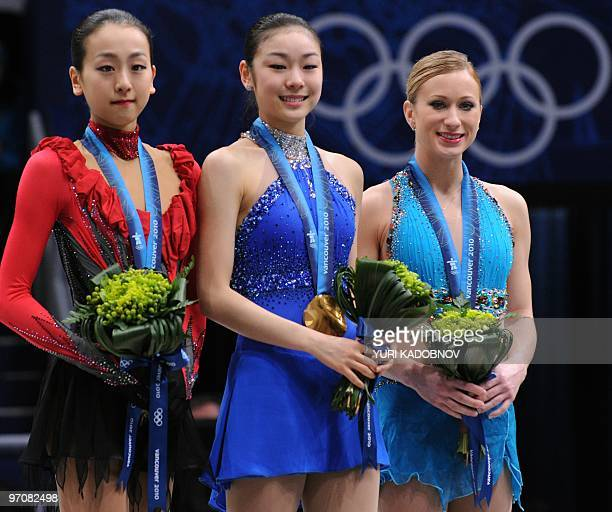 Gold medalist South Korea's YuNa Kim silver medalist Japan's Mao Asada and bronze medalist Canada's Joannie Rochette pose for a picture in the award...