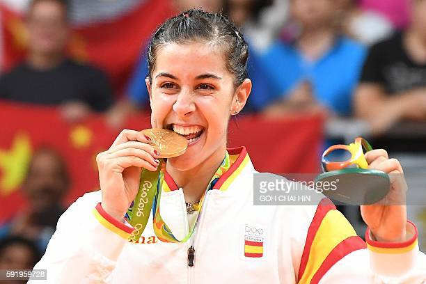 Gold medalist Spain's Carolina Marin celebrates on the podium following the women's singles Gold Medal badminton match at the Riocentro stadium in...