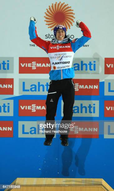 Gold medalist Stefan Kraft of Austria celebrates during the flower ceremony for the Men's Ski Jumping HS130 at the FIS Nordic World Ski Championships...