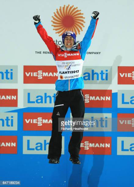 Gold medalist Stefan Kraft of Austria celebrates on the podium during the flowerr ceremony for the Men's Ski Jumping HS130 at the FIS Nordic World...