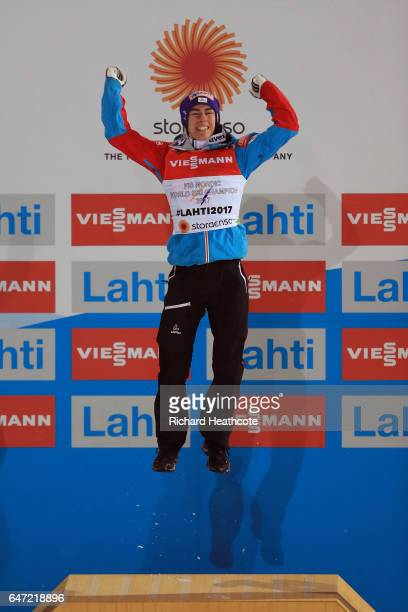 Gold medalist Stefan Kraft of Austria celebrates on the podium during the flower ceremony for the Men's Ski Jumping HS130 at the FIS Nordic World Ski...