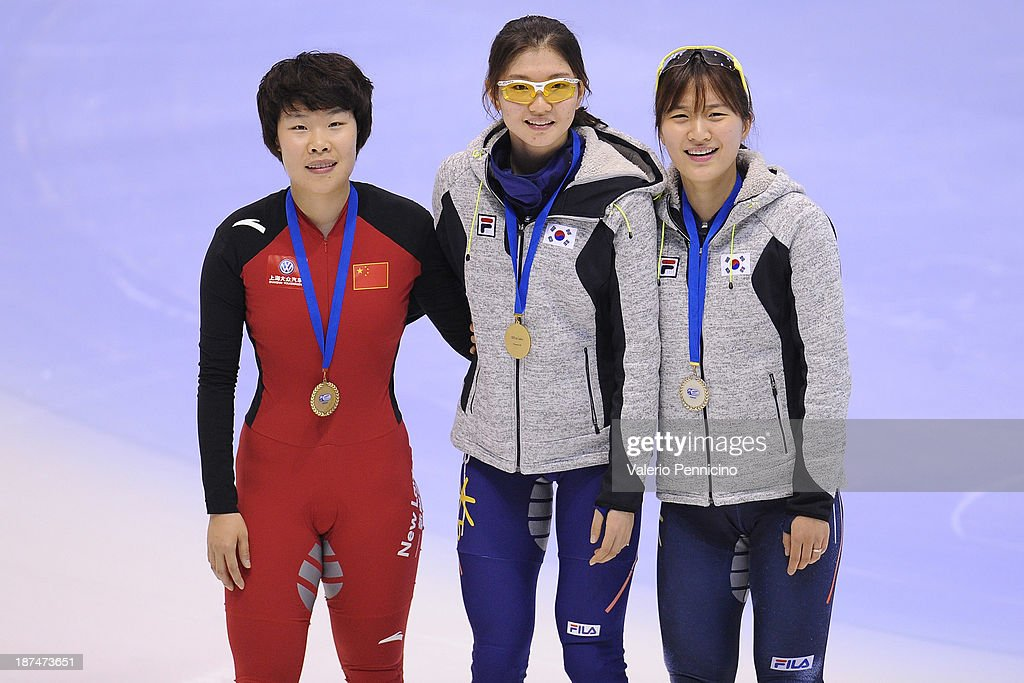 Gold medalist Suk Hee Shim of Korea (C), Silver medalist Seung-Hi Park of Korea (R) and Yang Zhou of China (Left) pose during the medal presentation for the Ladie's 1500m Final during day three of the Samsung ISU World Cup Short Track at the Palatazzoli on November 9, 2013 in Turin, Italy.