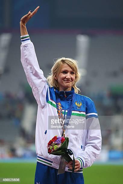 Gold medalist Svetlana Radzivil of Uzbekistan celebrates atop the podium following the Women's High Jump Final during day thirteen of the 2014 Asian...