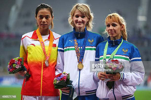 Gold medalist Svetlana Radzivil of Uzbekistan Silver medalist Zheng Xingjuan of China and Bronze medalist Nadiya Dusanova of Uzbekistan celebrate...