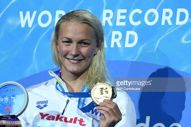 Gold medalist Sweden's Sarah Sjostrom celebrates on the podium of the women's 50m freestyle during the swimming competition at the 2017 FINA World...