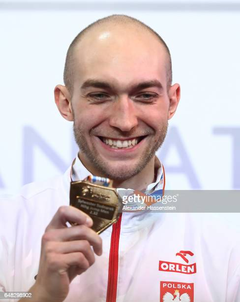 Gold medalist Sylwester Bednarek of Poland poses during the medal ceremony for the Men's High Jump on day three of the 2017 European Athletics Indoor...