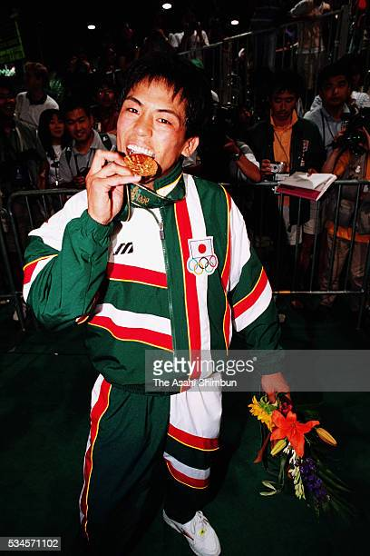 Gold medalist Tadahiro Nomura of Japan celebrate after the medal ceremony for the Judo Men's 60kg during the Atlanta Summer Olympic Games at the...
