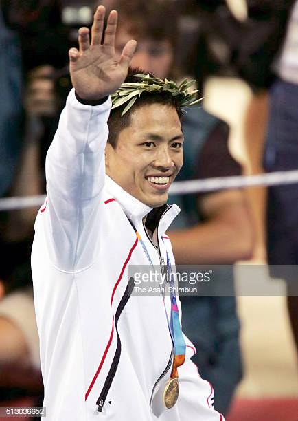 Gold medalist Tadahiro Nomura of Japan celebrates at the medal ceremony for the Judo Men's 60kg at the Ano Liossia Olympic Hall during day one of the...