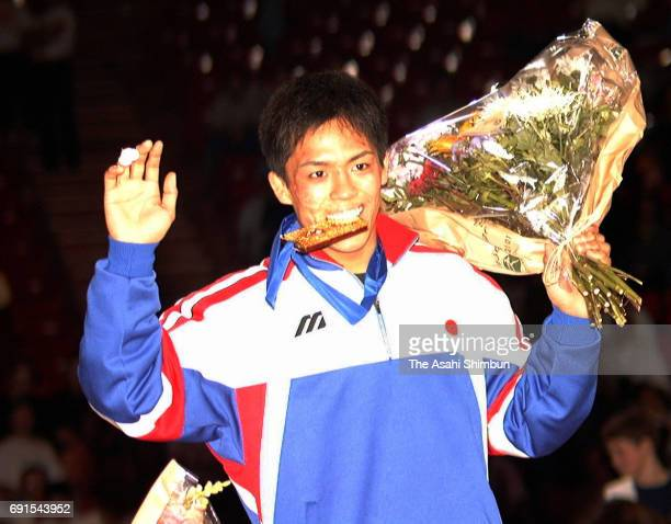 Gold medalist Tadahiro Nomura of Japan celebrates on the podium at the medal ceremony for the Men's 60kg during the World Judo Championships at Bercy...