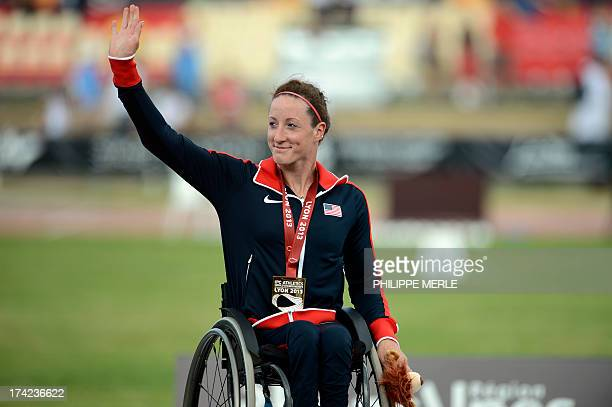 USA gold medalist Tatyanna McFadden poses on the podium of the Women's 5000m T54 at the IPC Athletics World Championships of Lyon on July 22 2013 at...