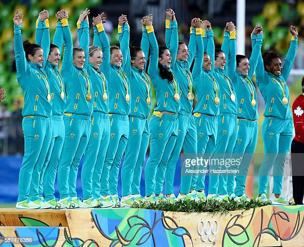 Gold medalist team Australia celebrate on the podium during the medal ceremony for the Women's Rugby Sevens on Day 3 of the Rio 2016 Olympic Games at...