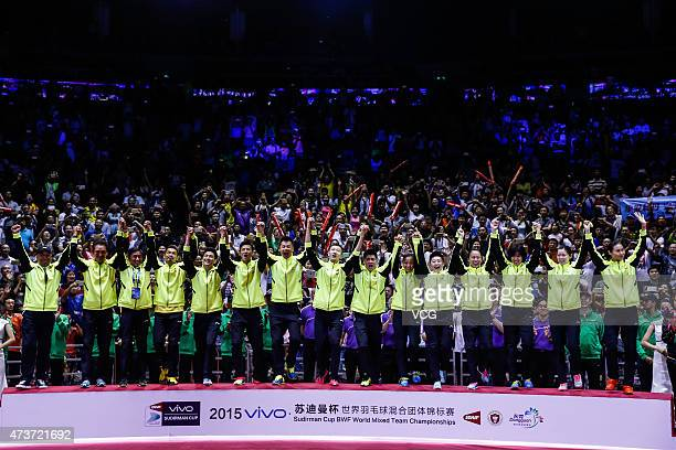 Gold medalist Team China pose on the podium during the award ceremony on day eight of 2015 Sudirman Cup BWF World Mixed Team Championships at...