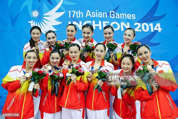 Gold medalist team of China pose for a picture with their medals during the victory ceremony after the team synchronised swimming Free Combination...
