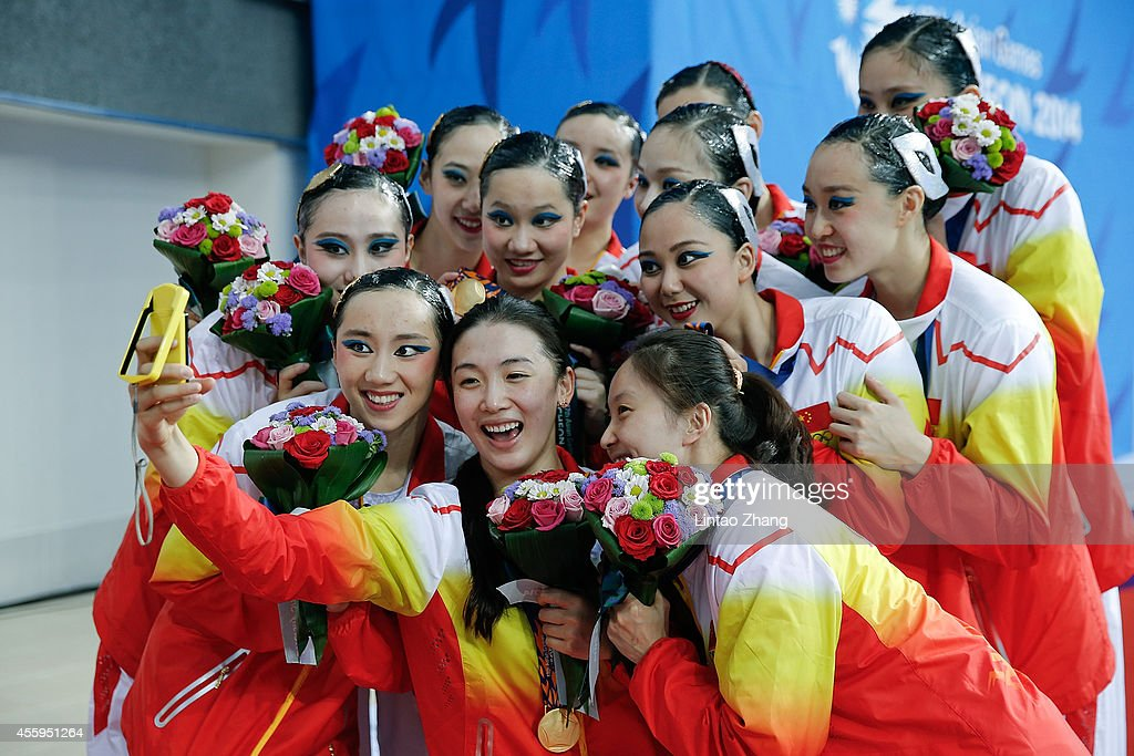 Gold medalist team of China pose for a selfie picture with their medals during the victory ceremony after the team synchronised swimming Free...