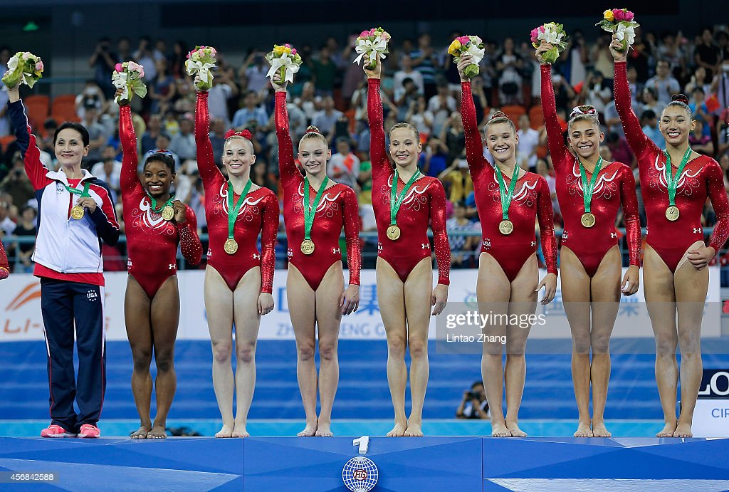Gold medalist team of the United States celebrates during the medal ceremony after the Women's Team Final on day two of the 45th Artistic Gymnastics...
