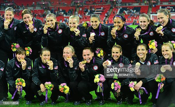 Gold medalist Team USA pose for photographers after the podium ceremony of the women's football competition of the London 2012 Olympic Games on...
