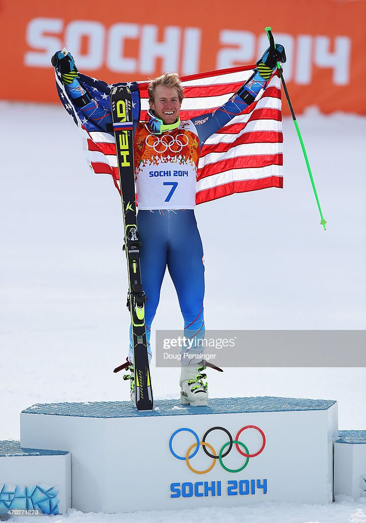 Gold medalist <a gi-track='captionPersonalityLinkClicked' href=/galleries/search?phrase=Ted+Ligety&family=editorial&specificpeople=580537 ng-click='$event.stopPropagation()'>Ted Ligety</a> of the United States celebrates during the flower ceremony for the the Alpine Skiing Men's Giant Slalom on day 12 of the Sochi 2014 Winter Olympics at Rosa Khutor Alpine Center on February 19, 2014 in Sochi, Russia.