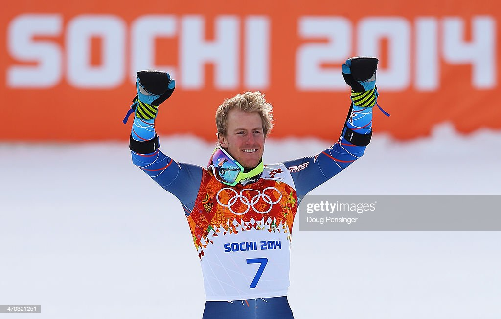 Gold medalist Ted Ligety of the United States celebrates during the flower ceremony for the the Alpine Skiing Men's Giant Slalom on day 12 of the Sochi 2014 Winter Olympics at Rosa Khutor Alpine Center on February 19, 2014 in Sochi, Russia.