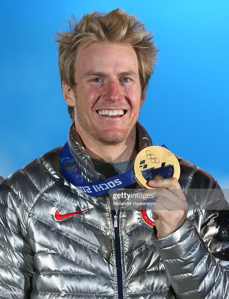 Gold medalist <a gi-track='captionPersonalityLinkClicked' href=/galleries/search?phrase=Ted+Ligety&family=editorial&specificpeople=580537 ng-click='$event.stopPropagation()'>Ted Ligety</a> of the United States celebrates during the medal ceremony for the Alpine Skiing Men's Giant Slalom on day thirteen of the Sochi 2014 Winter Olympics at at Medals Plaza on February 20, 2014 in Sochi, Russia.