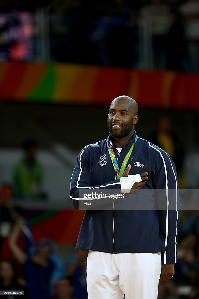 Gold medalist Teddy Riner of France celebrates on the podium after defeating Hisayoshi Harasawa of Japan during the Men's 100kg Judo Gold Medal...