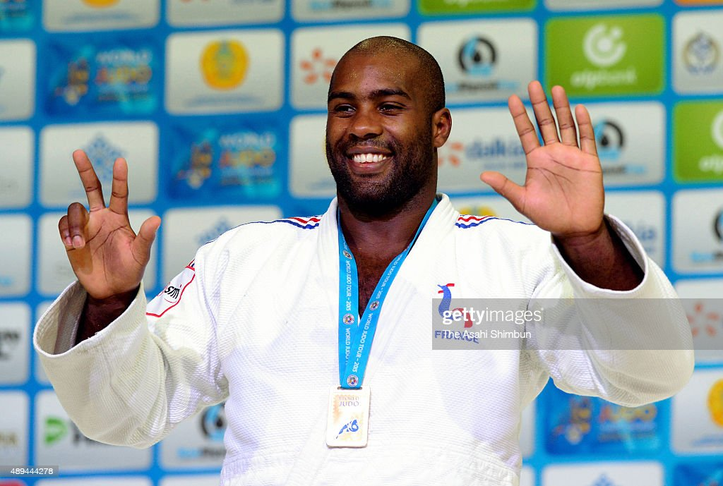 Gold medalist <a gi-track='captionPersonalityLinkClicked' href=/galleries/search?phrase=Teddy+Riner&family=editorial&specificpeople=4114927 ng-click='$event.stopPropagation()'>Teddy Riner</a> of France celebrates on the podium at the medal ceremony for the Men's +100kg during the 2015 Astana World Judo Championships at the Alau Ice Palace on August 29, 2015 in Astana, Kazakhstan.