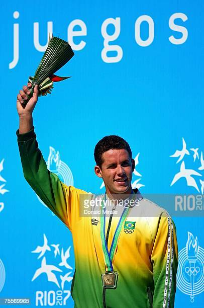 Gold medalist Thiago Pereira of Brazil celebrates on the podium after receiving his medal in the Men's 200 meter Individual Medley during the 2007 XV...