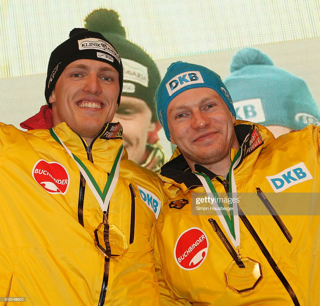 Gold medalist Thorsten Margis and Francesco Friedrich from Germany celebrate during the award ceremony after the 2 Man's Bobsleigh at Day 3 of the IBSF World Championships for Bob and Skeleton at Olympiabobbahn Igls on February 14, 2016 in Innsbruck, Austria.