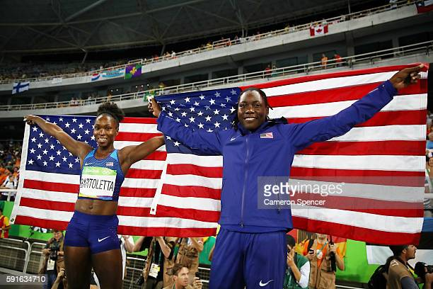 Gold medalist Tianna Bartoletta and silver medalist Brittney Reese of the United States celebrate with American flags after the Women's Long Jump...