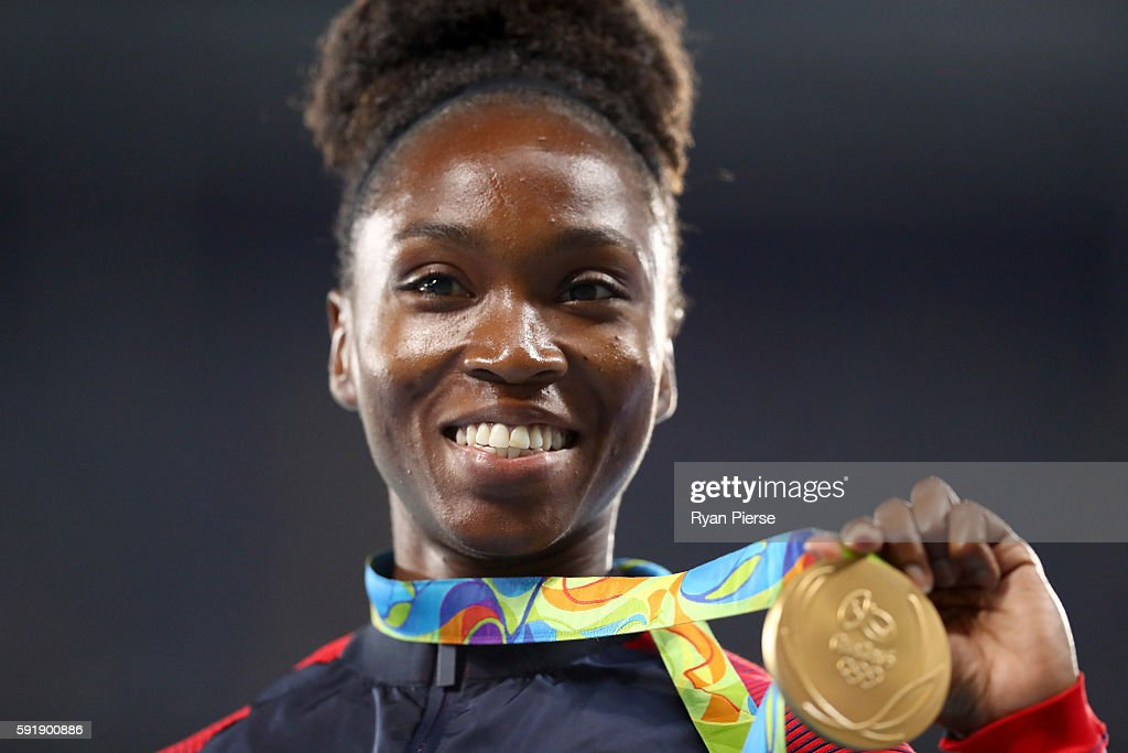 Gold medalist Tianna Bartoletta of the United States poses on the podium during the medal ceremony for the Women's Long Jump on Day 13 of the Rio...