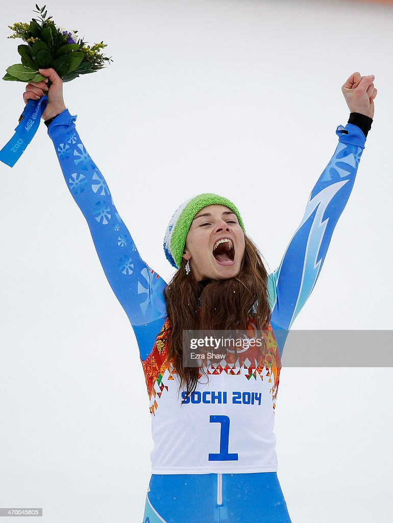 Gold medalist Tina Maze of Slovenia celebrates during the flower ceremony for the Alpine Skiing Women's Giant Slalom on day 11 of the Sochi 2014 Winter Olympics at Rosa Khutor Alpine Center on February 18, 2014 in Sochi, Russia.