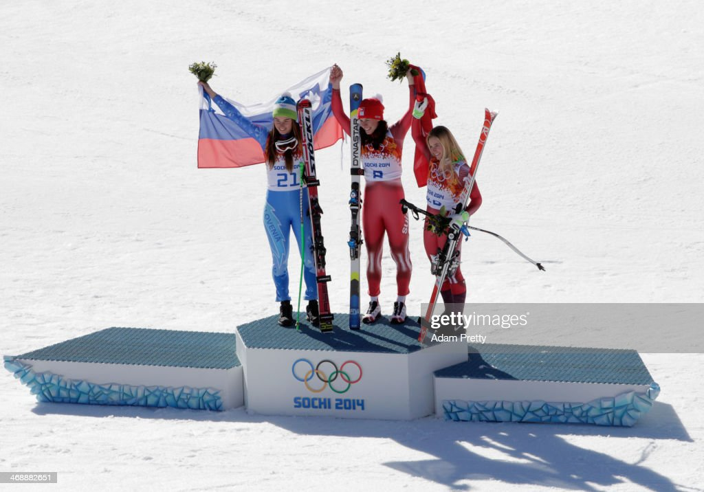 Gold medalist Tina Maze of Slovenia gold medalist Dominique Gisin of Switzerland and bronze medalist Lara Gut of Switzerland celebrate on the podium...