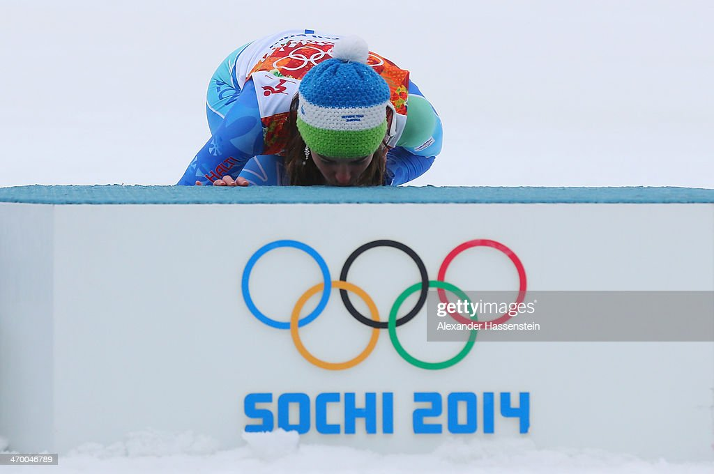 Gold medalist Tina Maze of Slovenia kisses the podium in celebration during the flower ceremony for the Alpine Skiing Women's Giant Slalom on day 11 of the Sochi 2014 Winter Olympics at Rosa Khutor Alpine Center on February 18, 2014 in Sochi, Russia.