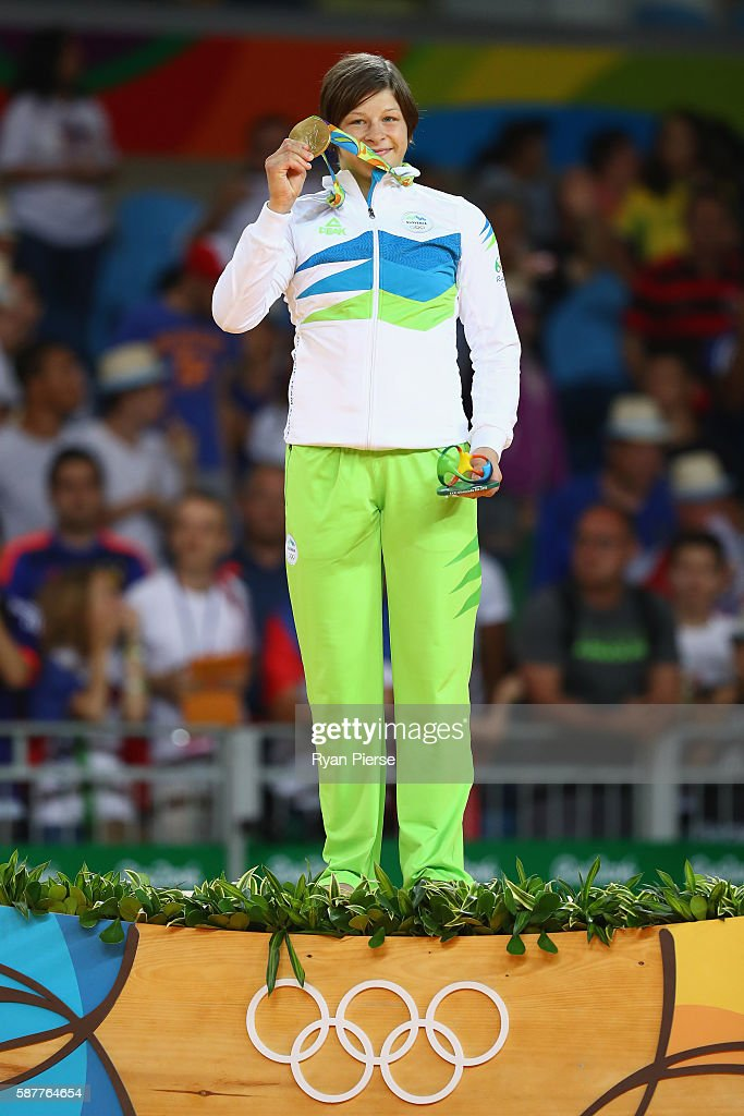 Gold medalist Tina Trstenjak of Slovenia poses on the podium during the medal ceremony for the Women's 63kg on Day 4 of the Rio 2016 Olympic Games at...