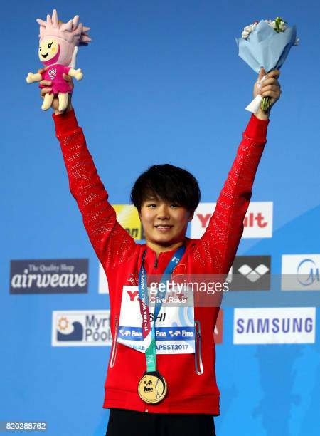 Gold medalist Tingmao Shi of China poses with the medal won during the Women's Diving 3m Springboard final on day eight of the Budapest 2017 FINA...