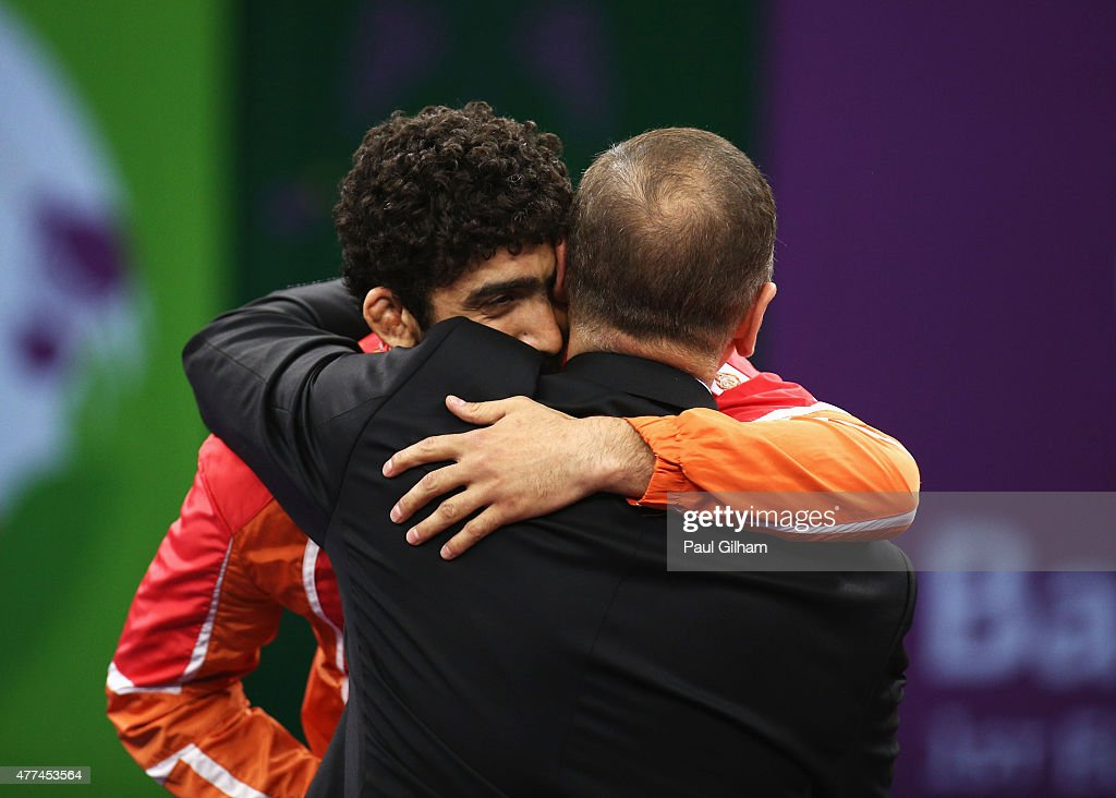 Gold medalist Togrul Asgarov of Azerbaijan embraces President of Azerbaijan <a gi-track='captionPersonalityLinkClicked' href=/galleries/search?phrase=Ilham+Aliyev&family=editorial&specificpeople=565601 ng-click='$event.stopPropagation()'>Ilham Aliyev</a> during the medal ceremony for the Men's Freestyle 65kg Final on day five of the Baku 2015 European Games at the Heydar Aliyev Arena on June 17, 2015 in Baku, Azerbaijan.