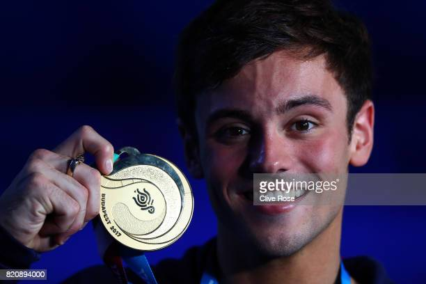 Gold medalist Tom Daley of Great Britain poses with the medal won during the Men's 10M Platform final on day nine of the Budapest 2017 FINA World...