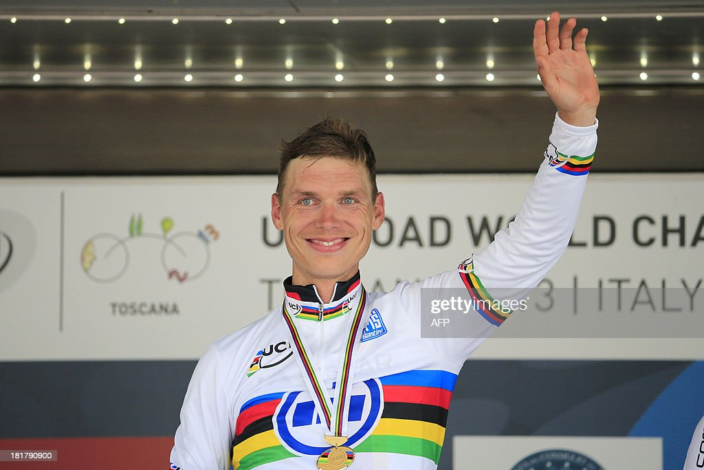 Gold medalist Tony Martin of Germany poses on the podium of the Elite Men's Time Trial of the UCI Road World Championships on September 25, 2013 in Florence, Italy.