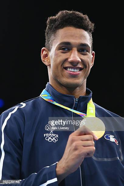 Gold medalist Tony Victor James Yoka of France poses on the podium during the medal ceremony for the Men's Boxing Super Heavy on Day 16 of the Rio...