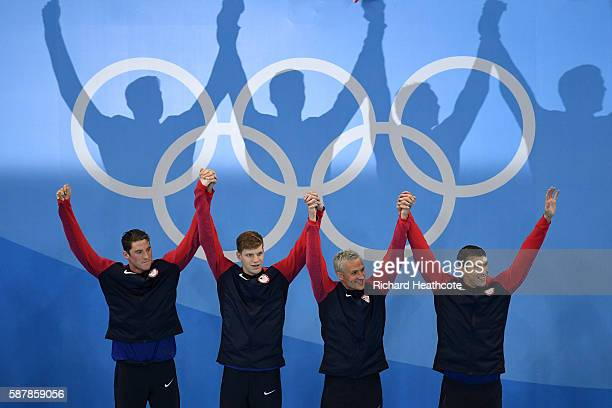 Gold medalist Townley Haas Conor Dwyer Ryan Lochte and Michael Phelps of the United States celebrate on the podium during the medal presentation for...