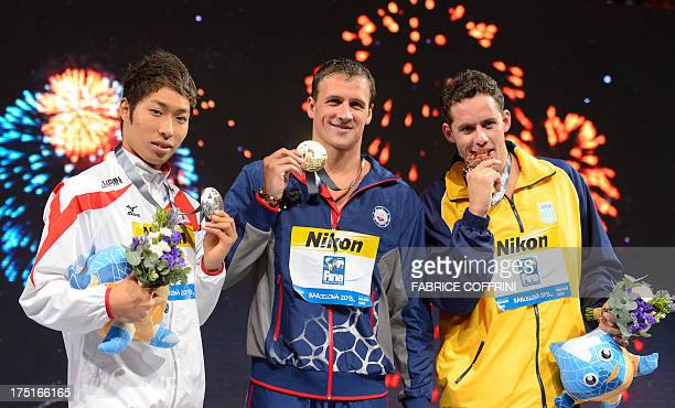 Gold medalist US swimmer Ryan Lochte silver medalist Japan's Kosuke Hagino and bronze medalist Brazil's Thiago Pereira pose on the podium during the...