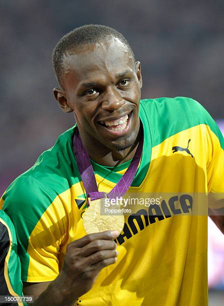 Gold medalist Usain Bolt of Jamaica celebrates during the medal ceremony for the Men's 200m on Day 13 of the London 2012 Olympic Games at Olympic...