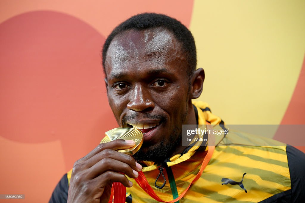 Gold medalist <a gi-track='captionPersonalityLinkClicked' href=/galleries/search?phrase=Usain+Bolt&family=editorial&specificpeople=604196 ng-click='$event.stopPropagation()'>Usain Bolt</a> of Jamaica poses during the medal ceremony for the Men's 100 metres final during day three of the 15th IAAF World Athletics Championships Beijing 2015 at Beijing National Stadium on August 24, 2015 in Beijing, China.