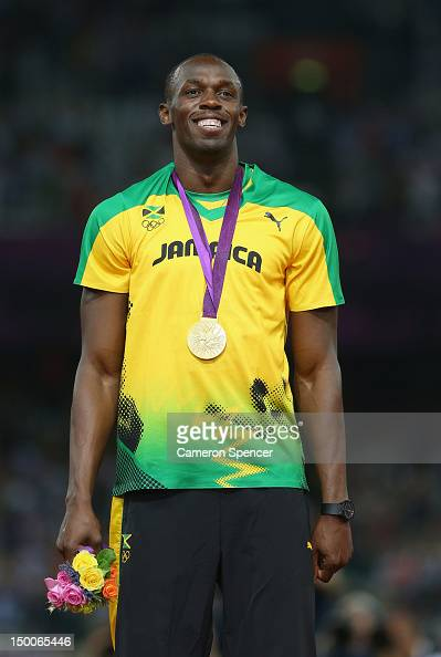 Gold medalist Usain Bolt of Jamaica poses on the podium during the medal ceremony for the Men's 200m on Day 13 of the London 2012 Olympic Games at...