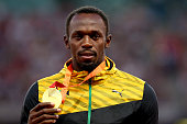 Gold medalist Usain Bolt of Jamaica poses on the podium during the medal ceremony for the Men's 200 metres final during day seven of the 15th IAAF...