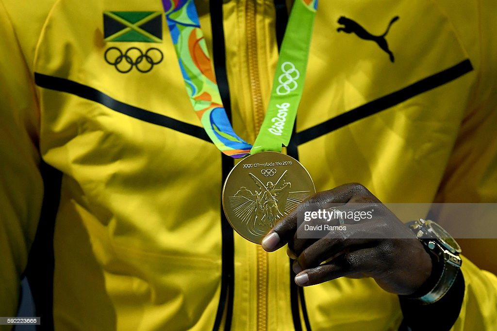 Gold medalist, Usain Bolt of Jamaica, poses on the podium during the medal ceremony for the Men's 200m on Day 14 of the Rio 2016 Olympic Games at the Olympic Stadium on August 19, 2016 in Rio de Janeiro, Brazil.
