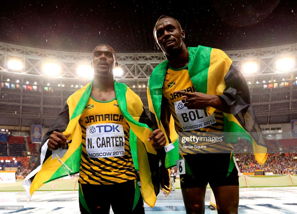 Gold medalist <a gi-track='captionPersonalityLinkClicked' href=/galleries/search?phrase=Usain+Bolt&family=editorial&specificpeople=604196 ng-click='$event.stopPropagation()'>Usain Bolt</a> of Jamaica poses with bronze medalist <a gi-track='captionPersonalityLinkClicked' href=/galleries/search?phrase=Nesta+Carter+-+Sprinter&family=editorial&specificpeople=4335396 ng-click='$event.stopPropagation()'>Nesta Carter</a> of Jamaica after the Men's 100 metres Final during Day Two of the 14th IAAF World Athletics Championships Moscow 2013 at Luzhniki Stadium on August 11, 2013 in Moscow, Russia.