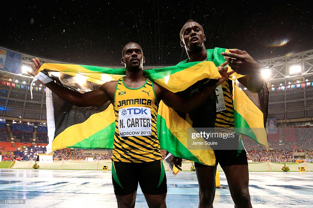 Gold medalist <a gi-track='captionPersonalityLinkClicked' href=/galleries/search?phrase=Usain+Bolt&family=editorial&specificpeople=604196 ng-click='$event.stopPropagation()'>Usain Bolt</a> of Jamaica poses with bronze medalist <a gi-track='captionPersonalityLinkClicked' href=/galleries/search?phrase=Nesta+Carter&family=editorial&specificpeople=4335396 ng-click='$event.stopPropagation()'>Nesta Carter</a> of Jamaica after the Men's 100 metres Final during Day Two of the 14th IAAF World Athletics Championships Moscow 2013 at Luzhniki Stadium on August 11, 2013 in Moscow, Russia.