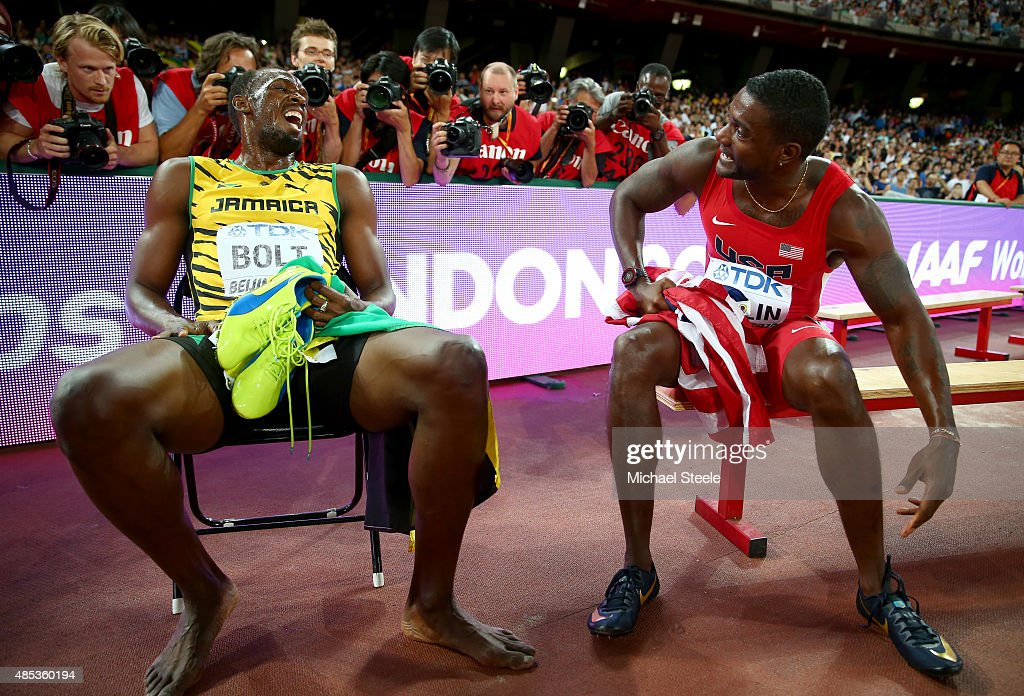 Gold medalist Usain Bolt of Jamaica talks with silver medalist Justin Gatlin of the United States after the Men's 200 metres final during day six of the 15th IAAF World Athletics Championships Beijing 2015 at Beijing National Stadium on August 27, 2015 in Beijing, China.